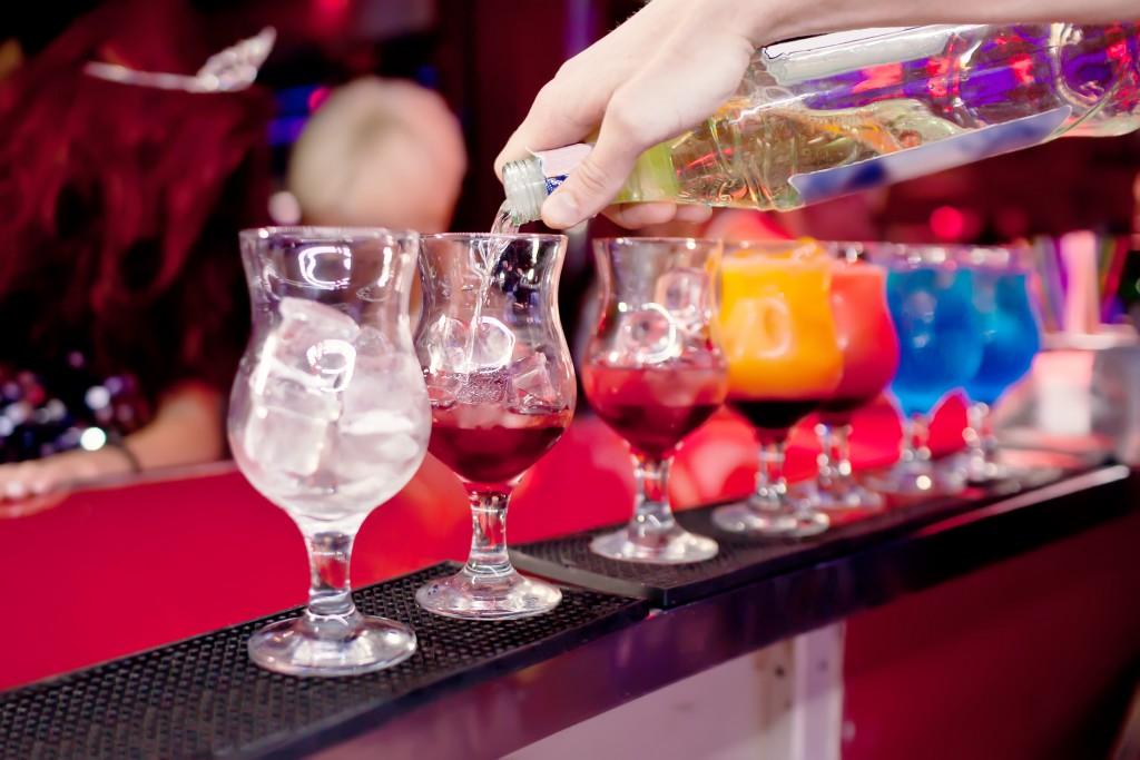 Barman  prepares exotic cocktails